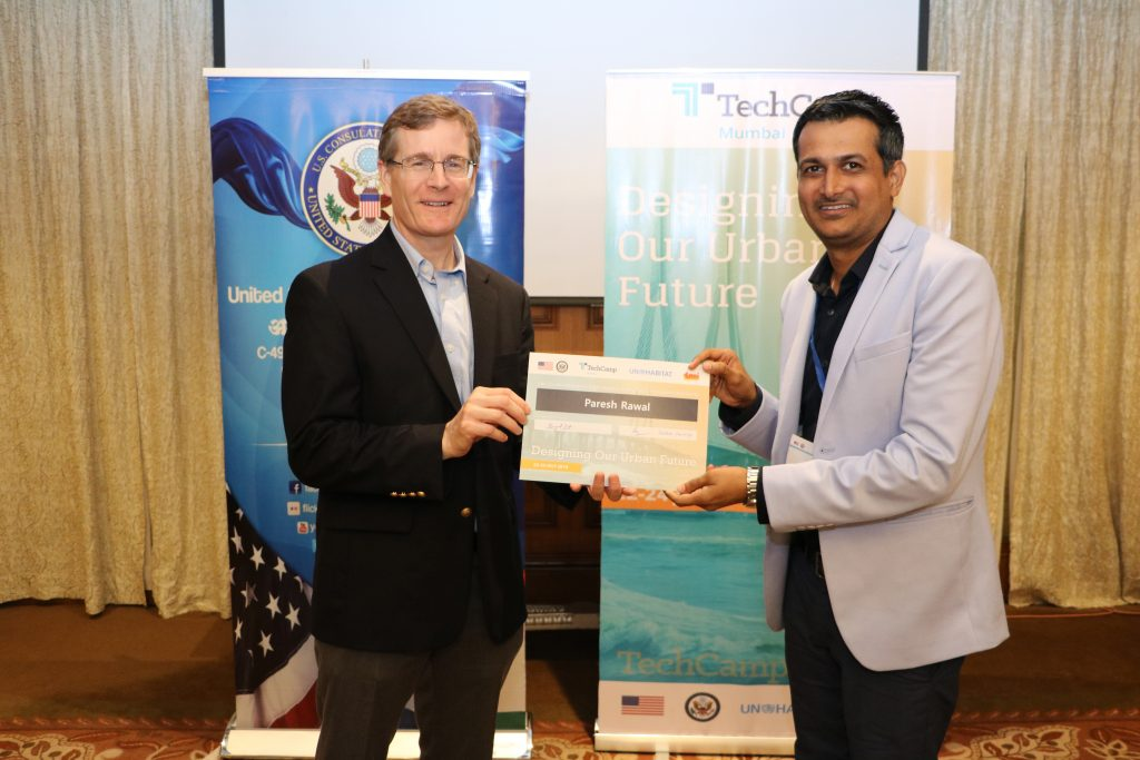 Receiving certificate at an event organised by US Consulate
